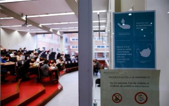 epa09254609 A banner informs on health measures outside a classroom during the University entrance exams at a faculty of Universitat de Barcelona University, in Barcelona, northeastern Spain, 08 June 2021. Some 40,000 students face University entrance exams in Catalonia from 08 June, after a odd school year amid coronavirus pandemic.  EPA/Quique García