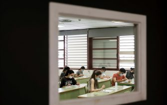 epa09254610 Students read their tests during the University entrance exams at a faculty of Universitat Politecnica in Valencia, eastern Spain, 08 June 2021. Some 24,500 students face University entrance exams in Valencia from 08 June, after a odd school year amid coronavirus pandemic.  EPA/Ana Escolar