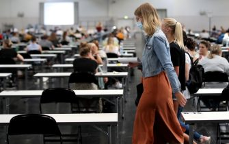 epa08507987 Over 700 students of the TU Dortmund University write their exams in German for Foreigners in the Westfalenhalle in Dortmund, Germany, 25 June 2020. In order to slow down the ongoing pandemic of COVID-19 disease caused by the SARS-CoV-2 coronavirus, about 7500 students will write their exams in the exhibition hall in the upcoming days, in compliance with the hygiene concept.  EPA/FRIEDEMANN VOGEL