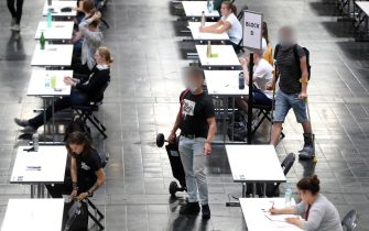 epa08507978 Over 700 students of the TU Dortmund University write their exams in German for Foreigners in the Westfalenhalle in Dortmund, Germany, 25 June 2020. In order to slow down the ongoing pandemic of COVID-19 disease caused by the SARS-CoV-2 coronavirus, about 7500 students will write their exams in the exhibition hall in the upcoming days, in compliance with the hygiene concept.  EPA/FRIEDEMANN VOGEL