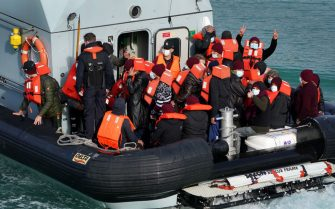 A group of people thought to be migrants are brought in to Dover, Kent, by Border Force officers following a small boat incident in the Channel. Picture date: Monday October 11, 2021. (Photo by Gareth Fuller/PA Images via Getty Images)