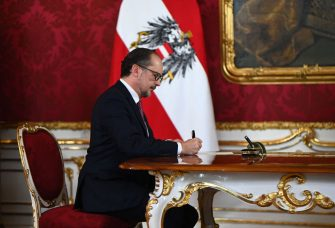 Austria's designated Chancellor Alexander Schallenberg signs his certificate of appointment during a swearing-in ceremony on October 11, 2021 at the presidential Hofburg Palace in Vienna. - Austria's Sebastian Kurz on Saturday, October 9, 2021 stepped down as chancellor, following pressure on him to resign after he was implicated in a corruption scandal. (Photo by Joe Klamar / AFP) (Photo by JOE KLAMAR/AFP via Getty Images)