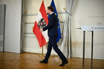 epa09515395 Austrian Chancellor Sebastian Kurz leaves after announcing his resignation during a press conference at the Chancellery in Vienna, Austria, 09 October 2021. Austrian Chancellor Kurz announced his resignation from the post on 09 October after The Austrian Economic and Corruption Prosecutor's Office (WKStA) has announced that it is investigating against Austrian Chancellor Kurz and nine other defendants on suspicion of embezzlement, bribery and corruption.  EPA/CHRISTIAN BRUNA