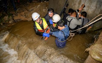 JINZHONG, CHINA - OCTOBER 10: Rescue teams pump water at flooded Jiexiu Fenhe wetland park on October 10, 2021 in Jinzhong, Shanxi Province of China. Heavy rains have caused floods and disasters in Shanxi Province. (Photo by Wei Liang/China News Service via Getty Images)