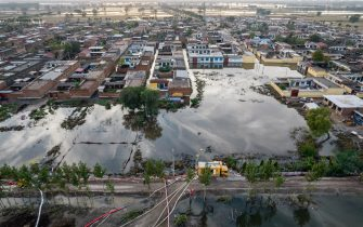This aerial photo taken on October 10, 2021 shows a flooded area after heavy rainfalls in Jiexiu, in Jinzhong city, China's northern Shanxi province. - China OUT (Photo by STR / AFP) / China OUT (Photo by STR/AFP via Getty Images)