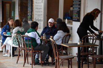 epa09517691 Diners sit a a cafe following 108 days of lockdown at Bronte in Sydney, Australia, 11 October 2021. Having surpassed the 70 percent double-dose vaccination milestone early, gyms, cafes, restaurants, pools, shops, hairdressers and beauticians will reopen in New South Wales from Monday 11 October 2021.  EPA/JOEL CARRETT AUSTRALIA AND NEW ZEALAND OUT