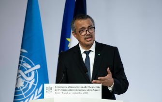 WHO Director-General Tedros Adhanom Ghebreyesus delivers a speech  French President Emmanuel Macron attending the  ceremony for the opening of the World Health Organisation Academy in Lyon, eastern France, on September 27, 2021.
