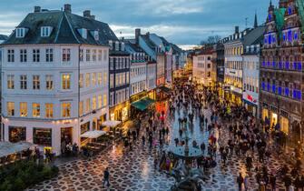 Denmark, Sjelland, Copenhagen . Amagertorv (Amager Square), the Stork Fountain and Strøget street, the main shopping street in Copenhagen