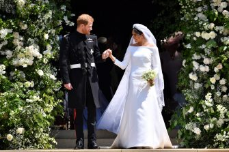 WINDSOR, UNITED KINGDOM - MAY 19: Britain's Prince Harry, Duke of Sussex and his wife Meghan, Duchess of Sussex leave from the West Door of St George's Chapel, Windsor Castle, in Windsor on May 19, 2018 in Windsor, England. (Photo by  Ben STANSALL - WPA Pool/Getty Images)