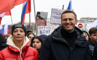 Russian opposition leader Alexei Navalny and his wife Yulia take part in a march in memory of murdered Kremlin critic Boris Nemtsov in central Moscow on February 24, 2019. - The 55-year-old former first deputy prime minister under Boris Yeltsin was shot in the back several times just before midnight on February 27, 2015 as he walked across a bridge a stone's throw from the Kremlin walls. (Photo by Kirill KUDRYAVTSEV / AFP)        (Photo credit should read KIRILL KUDRYAVTSEV/AFP via Getty Images)