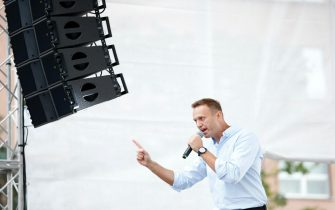 Russian opposition leader Alexei Navalny addresses demonstrators during a rally to support opposition and independent candidates after authorities refused to register them for September elections to the Moscow City Duma, Moscow, July 20, 2019. (Photo by Maxim ZMEYEV / AFP)        (Photo credit should read MAXIM ZMEYEV/AFP via Getty Images)