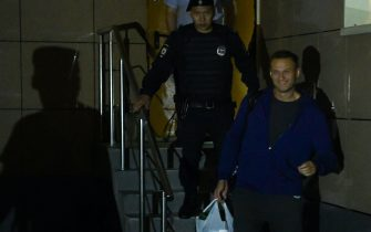Russian opposition leader Alexei Navalny leaves a court surrounded by a police officer after being sentenced to 30 days in jail for repeatedly violating demonstration regulations, Moscow, July 24, 2019. (Photo by Kirill KUDRYAVTSEV / AFP)        (Photo credit should read KIRILL KUDRYAVTSEV/AFP via Getty Images)