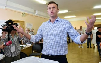 Russian opposition activist Alexei Navalny reacts after casting his vote at a polling station during to the Moscow city Duma election in Moscow on September 8, 2019. - Russians vote in local and regional elections on September 8, 2019. (Photo by Vasily MAXIMOV / AFP)        (Photo credit should read VASILY MAXIMOV/AFP via Getty Images)