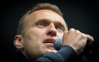 """Russian opposition leader Alexei Navalny delivers a speech during a demonstration in Moscow on September 29, 2019. - Thousands gathered in Moscow for a demonstration demanding the release of the opposition protesters prosecuted in recent months. Police estimated a turnout of 20,000 people at the Sakharov Avenue in central Moscow about half an hour after the start of the protest, which was authorised. The demonstrators chanted """"let them go"""" and brandished placards demanding a halt to """"repressions"""" of opposition protesters. (Photo by Yuri KADOBNOV / AFP)        (Photo credit should read YURI KADOBNOV/AFP via Getty Images)"""