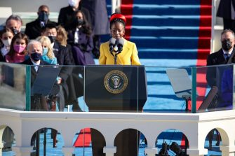 WASHINGTON, DC - JANUARY 20: Youth Poet Laureate Amanda Gorman speaks at the inauguration of U.S. President Joe Biden on the West Front of the U.S. Capitol on January 20, 2021 in Washington, DC. During today's inauguration ceremony Joe Biden becomes the 46th president of the United States.   Rob Carr/Getty Images/AFP == FOR NEWSPAPERS, INTERNET, TELCOS & TELEVISION USE ONLY ==