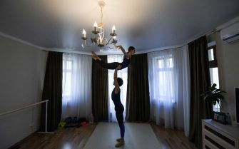 Bolshoi theatre leading soloist Igor Tsvirko and first soloist Margarita Shrainer attend a lesson in their apartment in Moscow on April 29, 2020 during a strict lockdown in Russia to stop the spread of the COVID-19 infection caused by the novel coronavirus. - In the middle of their bedroom, Bolshoi ballet dancers Margarita Shrainer and Igor Tsvirko have placed a linoleum mat and a barre. Since the start of the lockdown, the couple, both soloists in the legendary troupe, have largely used their own initiative to keep up their dance skills at home. (Photo by Kirill KUDRYAVTSEV / AFP) (Photo by KIRILL KUDRYAVTSEV/AFP via Getty Images)