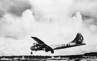 The Enola Gay lands back on Tinian after dropping the first military atomic bomb on Hiroshima.