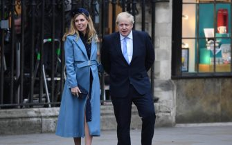 epa08281503 British Prime Minister, Boris Johnson waves as he leaves with his girlfriend Carrie Symonds the annual Commonwealth Service at Westminster Abbey in London, Britain, 09 March 2020. The service is an event where members of Britain's Royal family celebrate the Commonwealth - a global network of 54 countries. The event is the Sussex's final official royal engagement since announcing their intention of giving up Royal duties.  EPA/FACUNDO ARRIZABALAGA