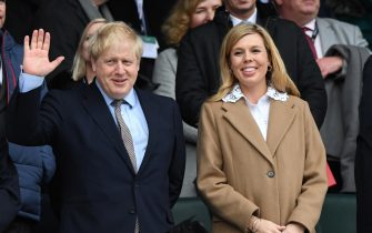 epa08276908 British Prime Minister, Boris Johnson and his partner Carrie Symonds ahead of the Six Nations rugby match between England and Wales held at Twickenham stadium in London, Britain, 07 March 2020.  EPA/FACUNDO ARRIZABALAGA