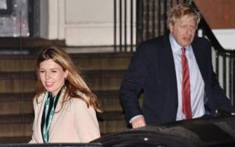 epa08067620 Britain's Prime Minister Boris Johnson (R) and his girlfriend Carrie Symonds (L) leave the Conservative party headquarters in London, Britain, 13 December 2019. Britons went the polls on 12 December 2019 in a general election to vote for a new parliament. Britons went to the polls on 12 December 2019 in a general election to vote for a new parliament. According to exit polls, the Conservative party won the elections with 368 seats ahead of Labour party with 191 seats in the House of Commons. The result gives the Conservative party an 86 seat majority.  EPA/NEIL HALL