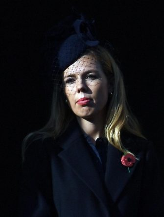 epa07985913 Carrie Symonds, partner of Prime Minister Boris Johnson at the Cenotaph on Whitehall during the Remembrance Sunday day service in London, Britain, 10 November 2019.  Britain is remembering its war dead on the 101st anniversary since the end of the first world war.  EPA/ANDY RAIN