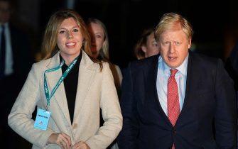 epa08067529 British Prime Minister Boris Johnson (R) and Carrie Symonds (L) arrive at the count result for Uxbridge and South Ruislip constituency at Brunel University during the general elections in London, Britain, 13 December 2019. Britons went to the polls on 12 December 2019 in a general election to vote for a new parliament. According to exit polls, the Conservative party won the elections with 368 seats ahead of Labour party with 191 seats in the House of Commons. The result gives the Conservative party an 86 seat majority.  EPA/WILL OLIVER