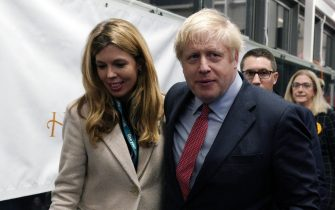epa08067480 British Prime Minister Boris Johnson (R) and Carrie Symonds (L) arrive to view the vote count results for Uxbridge and South Ruislip constituency at Brunel University during the general elections in London, Britain, 13 December 2019. Britons went to the polls on 12 December 2019 in a general election to vote for a new parliament. According to exit polls, the Conservative party won the elections with 368 seats ahead of Labour party with 191 seats in the House of Commons. The result gives the Conservative party an 86 seat majority.  EPA/WILL OLIVER