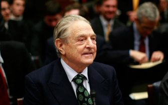 """WASHINGTON - NOVEMBER 13:  Hedge fund manager George Soros, chairman of Soros Fund Management LLC, arrives before the House Oversight and Government Reform Committee November 13, 2008 in Washington, DC.  Soros testified on the topic of """"The Regulation of Hedge Funds"""" during the hearing.  (Photo by Win McNamee/Getty Images)"""