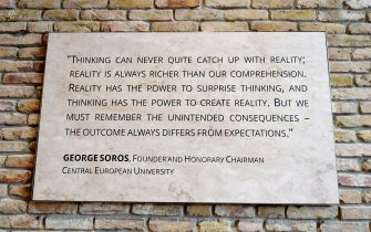 A quote of the founder of the English-language Central European University (CEU) Hungarian born American businessman George Soros is seen at the main entrance in Budapest on March 29, 2017.  The English-language CEU set up in Budapest by Hungarian born American businessman Georg Soros in 1991 after the fall of communism, has long been seen as a hostile bastion of liberalism by Prime Minister Viktor Orban's right-wing government. / AFP PHOTO / ATTILA KISBENEDEK        (Photo credit should read ATTILA KISBENEDEK/AFP via Getty Images)