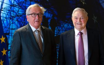 EU commission President Jean-Claude Juncker (L) welcomes George Soros, Founder and Chairman of the Open Society Foundations prior to a meeting in Brussels, on April 27, 2017.  Meeting will mainly focus on situation in Hungary, including legislative measures that could force the closure of the Central European University in Budapest. / AFP PHOTO / POOL / OLIVIER HOSLET        (Photo credit should read OLIVIER HOSLET/AFP via Getty Images)