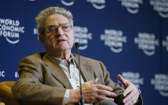 """DAVOS, Switzerland:  George Soros, Chairman of Soros Fund management speaks during the """"Riding the Next Democratic Wave"""" conference, 23 January 2004 at the Congress Center during the World Economic Forum (WEF) in Davos. In a speech prepared for the WEF, UN Secretary General Kofi Annan announced Today he was convening a new business summit in June In New York, to help refocus attention on development issues that have been overshadowed by the Iraq war and the US-led drive against terrorism.AFP PHOTO Philippe DESMAZES  (Photo credit should read PHILIPPE DESMAZES/AFP via Getty Images)"""