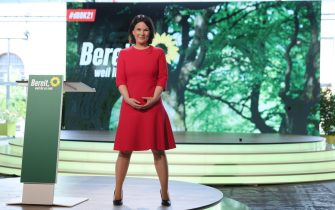 epa09264687 Annalena Baerbock, co-head of the German Greens Party, smiles after she spoke at the Greens Party virtual federal party congress shortly after delegates confirmed Baerbock as the party's candidate for chancellor, in Berlin, Germany, 12 June 2021. The Greens, who were in first place in polls only weeks ago, have seen their poll ratings dip, in part due to fumbles of their own doing. Germany is to hold federal elections in September 2021.  EPA/SEAN GALLUP / POOL