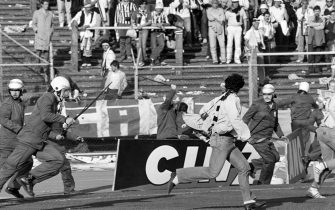 Belgium policemen run after Italian fans on May 29, 1985 in Heysel stadium in Brussels, as violence has broken out one hour before the European Champion Clubs final between Britain's Liverpool and Italy's Juventus of Turin, killing 39 fans and injuring more than 600. The tragedy occured when a wall collapsed in the stadium under the pressure of people and crushed Juventus fans as they tried to escape Liverpool supporters.        (Photo credit should read DOMINIQUE FAGET/AFP via Getty Images)