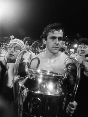 A thoughtful Michel Platini holds the cup, on May 29, 1985 after the Juventus victory on Liverpool, at European Champion Clubs final, at the Heysel stadium. Violence broke out between Britain's Liverpool hooligans and Italy's Juventus of Turin supporters one hour before the beginning of the match, killing 39 fans and injuring more 600 others. The tragedy occured when a wall collapsed in the stadium under the pressure of people and crushed Juventus fans as they tried to escape Liverpool supporters.        (Photo credit should read DOMINIQUE FAGET/AFP via Getty Images)