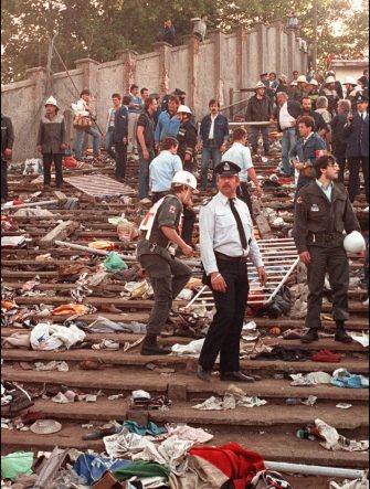 Rescuers search for victims on May 29, 1985 at the scene of riots in Heysel football stadium in Brussels after thirty-nine fans died during violences at the European Cup Final in Brussels. Shortly before kick off the atmosphere turned violent and Liverpool supporters stampeded through a thin line of police towards the rival fans. As the Juventus fans retreated a wall collapsed under the pressure and fans were crushed and trampled to death in the panic. AFP PHOTO DOMINIQUE FAGET (Photo by DOMINIQUE FAGET / AFP) (Photo by DOMINIQUE FAGET/AFP via Getty Images)