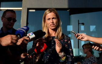 Kate McCann (C), mother of missing British girl Madeleine McCann, speaks to the press outside the court house in Lisbon on September 12, 2013 following the first audience of the McCann couple's libel proceedings against former inspector Goncalo Amaral for a book written about the case of their missing daughter. Kate McCann and her husband Gerry are suing Amaral in a Lisbon court for the book in which he argues Madeleine was killed accidentally and implicates her parents in her alleged 2007 death. AFP PHOTO/ FRANCISCO LEONG        (Photo credit should read FRANCISCO LEONG/AFP via Getty Images)