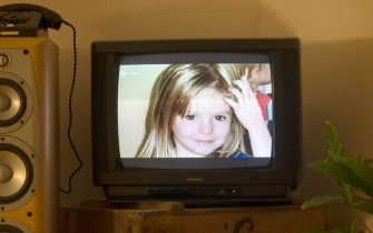 """A photo of British girl Madeleine McCann aka Maddie is displayed on a TV screen at an appartmen in Berlin, on October 16, 2013 during the broadcast of German ZDF's """"Aktenzeichen XY"""" programme. The German broadcaster received more than 500 phone calls and emails after airing the programme on the 2007 disappearance of British toddler Madeleine McCann in Portugal, the station said on October 16, 2013. The appeal, based on two years of work raking over the case by Scotland Yard's officers, was first broadcast in Great Britain on the BBC's """"Crimewatch"""" programme.  AFP PHOTO / JOHANNES EISELE"""
