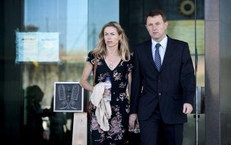 Kate McCann (L) and her husband Gerry McCann (R), parents of missing British youngster Madeleine McCann, leave the court house in Lisbon after delivering statements in their case against Portuguese police officer Goncalo Amaral on July 8, 2014. The McCanns, whose daughter Madeleine disappeared in Portugal in 2007, are suing Goncalo Amaral for libel and had flown from England to Lisbon to deliver personal impact statements at the Palace of Justice. Madeleine disappeared from a bedroom of her family's holiday apartment in the Algarve resort of Praia da Luz a few days short of her fourth birthday as her parents dined with friends at a nearby tapas restaurant.  AFP PHOTO / PATRICIA DE MELO MOREIRA        (Photo credit should read PATRICIA DE MELO MOREIRA/AFP via Getty Images)