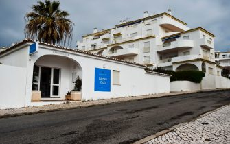 """A picture taken on April 28, 2017 shows the main entrance of the apartments hotel """"Luz Oceans Club - Garden Club"""" where the McCann where staying during the night of Maddie's disappearance at Praia da Luz in Algarve, southern Portugal. Scarred by Madeleine McCann's disappearance 10 years ago, the seaside resort town of Praia da Luz in southern Portugal is struggling to shake off the mystery of the young British girl's disappearance. Madeleine McCann (Maddie) disappeared on May 3, 2007. Portuguese police closed the case in 2008 before reopening it five years later. / AFP PHOTO / PATRICIA DE MELO MOREIRA        (Photo credit should read PATRICIA DE MELO MOREIRA/AFP via Getty Images)"""
