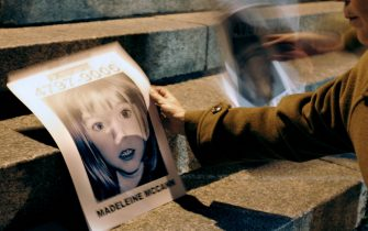 Buenos Aires, ARGENTINA: A woman holds a picture of missing British girl Madeleine McCann next to another of a missing Argentine child, during a demo by Missing Children Argentina and Red Solidaria organizations near the British embassy in Buenos Aires 11 June, 2007. AFP PHOTO / JUAN MABROMATA (Photo credit should read JUAN MABROMATA/AFP via Getty Images)