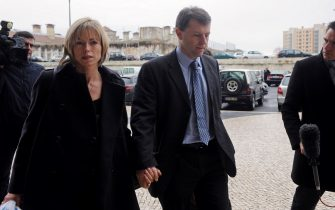 The parents of missing British girl Madeleine McCann Gerry (C) and Kate McCann (L) arrive at Tribunal Civil de Lisboa in Lisbon on February 10, 2010, after the lunch break for the last court session of their libel action against Goncalo Amaral the Portuguese police officer who led the initial probe in the case.  Kate and Gerry McCann are suing Amaral for 1.2 million euros (1.7 million dollars) for defamation over allegations he made in a book that their daughter was dead and that they were involved in her disappearance.  Madeleine went missing from a holiday apartment in the Algarve resort of Praia da Luz on May 3, 2007, a few days before her fourth birthday, as her parents and their friends dined at a nearby restaurant. AFP PHOTO/ FRANCISCO LEONG (Photo credit should read FRANCISCO LEONG/AFP via Getty Images)
