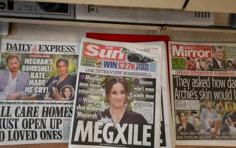 epa09061809 British newspapers on a stand after the US television interview by Oprah Winfrey of Britain's Prince Harry and Meghan Markle, the Duke and Duchess of Sussex in London, Britain, 08 March 2021. ITV will air the interview to the United Kingdom tonight at 9pm.  EPA/FACUNDO ARRIZABALAGA
