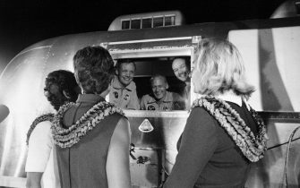 A file handout photo provided by NASA dated 27 July 1969 shows the Apollo 11 astronauts, Neil A. Armstrong, Edwin E. Aldrin, and Michael Collins, still in their quarantine van, being greeted by their wives upon arrival at Ellington Air Force Base near Houston, Texas, USA.  ANSA/NASA / HO  EDITORIAL USE ONLY