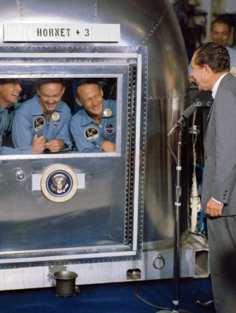 epa03370279 (FILE) A undated NASA handout photo showing US President Richard M. Nixon (R) welcoming in the central Pacific recovery area the Apollo 11 astronauts aboard the USS Hornet, prime recovery ship for the historic Apollo 11 lunar landing mission. Already confined to the Mobile Quarantine Facility (MQF) are from L-R Neil A. Armstrong, commander; Michael Collins, command module pilot; and Edwin E. Aldrin Jr., lunar module pilot. Apollo 11 splashed down at 11:49 a.m. (CDT), 24 July 1969, about 812 nautical miles southwest of Hawaii and only 12 nautical miles from the USS Hornet. Neil Armstrong, the 1st man on the moon, has died at age 82,it was reported 25 August 2012.  EPA/NASA / HANDOUT  HANDOUT EDITORIAL USE ONLY