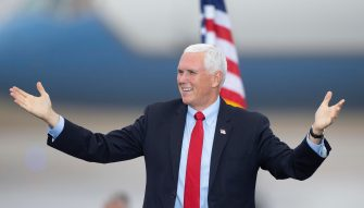 epa08763122 US Vice President Mike Pence gestures to the crowd during a campaign stop in Portsmouth, New Hampshire, USA, 21 October 2020. Vice President Pence and President Donald J. Trump face former Vice President Joe Biden and Senator Kamala Harris in the 03 November 2020 general election.  EPA/CJ GUNTHER