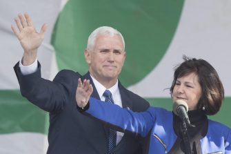 epa05755214 US Vice President Mike Pence (L) and his wife Karen Pence (R) wave at the 44th March for Life, on the National Mall in Washington, DC, USA, 27 January 2017. Thousands of people gathered to participate in the annual march that protests Roe v. Wade, the landmark ruling that legalized abortion in the United States.  EPA/MICHAEL REYNOLDS