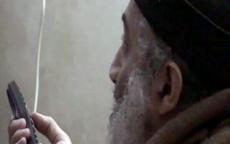 epa02723156 Undated video frame grab released 07 May 2011 by the US Department of Defense and made available on 08 May 2011 shows Osama bin Laden speaking. Five videos were released minute their audio tracks by the US Government from among those found in bin Laden's compound in Abbottabad, Pakistan after U.S. Navy Seals stormed the compound and killed bin Laden.  EPA/DEPARTMENT OF DEFENSE / HANDOUT  HANDOUT EDITORIAL USE ONLY