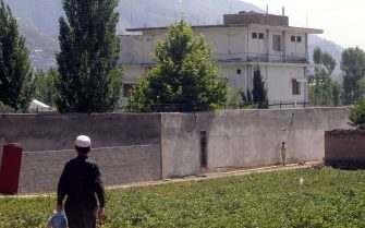 epa02715485 Local resident passes by the compound where Osama Bin Laden, the leader of terrorist network Al-Qaeda was killed by US military forces, in Abbottabad, Pakistan on 03 May 2011. Al-Qaeda founder and leader Osama Bin Laden was killed on 01 May in Abbottabad, Pakistan by US forces.  EPA/MD NADEEM