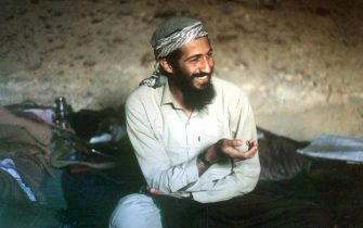 epa02713450 (FILES) Saudi-born billionaire Osama Bin Laden smiles as he sits in a cave in the Jalalabad region of Afghanistan in this 1988 photo. A CIA-led operation has killed Osama bin Laden in Pakistan and recovered his body after a tortuous decadelong hunt for the elusive militant leader who commanded the terrorist attacks of 11 September 2001. The al-Qaeda leader was killed in a ground operation in a mansion outside Islamabad in an operation, according to U.S. President Obama in a nation address early, 02 May 2011.  EPA/STR