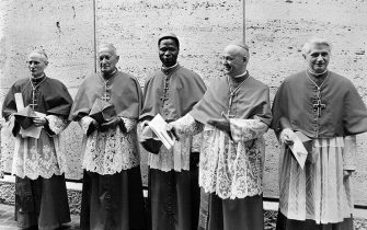 """Picture dated 07 June 1977 shows German cardinal Joseph Ratzinger (R) at the Vatican city next to Cardinals Benelli (2ndR), Gantin (C), Tomazek (2ndL) and Gappi (L). German Cardinal Joseph Ratzinger, who was elected 19 April 2005 to succeed Pope John Paul II, was a close confidant of the late pontiff and fellow conservative. The newly elected Pope Benedict XVI, who turned 78 on Saturday, will be expected to maintain John Paul II's deeply conservative line. He has railed against """"greed"""" and """"self-sufficiency"""" within the Roman Catholic Church and rejects any attempt to modernise.        (Photo credit should read STF/AFP via Getty Images)"""